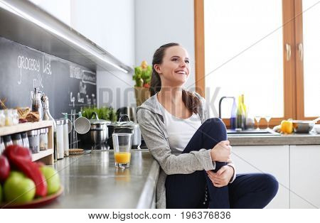 Woman in the kitchen. Cooking at kitchen.