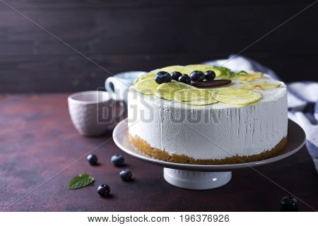 yogurt mousse cake on a plate on a brown stone background
