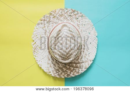 Summer Minimal Background Concept. Straw Hat On Yellow And Blue Background.