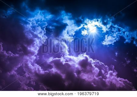 Amazing landscape of natural cloudscape background. Beauty colorful sky with sunbeam in dark clouds. Sunlight with lens flare. Beautiful nature composition. Outdoor at the daytime on summer day. poster