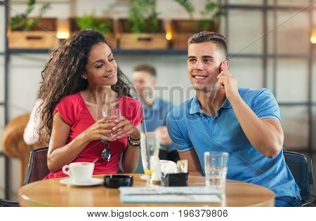 Young couple enjoying the coffee shop after shopping