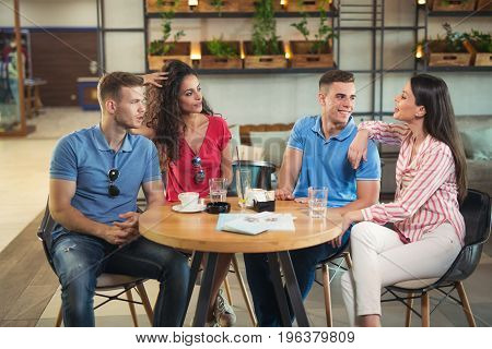 Group of young people meeting in a cafe.