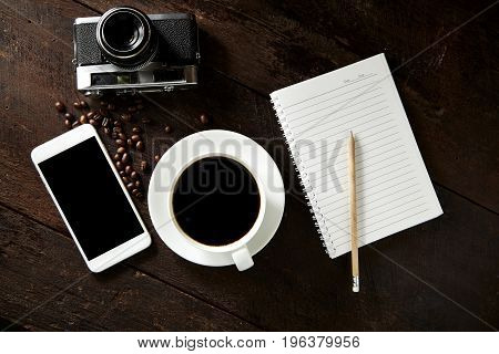 Cup Of Coffee And Smartphone On The Wood