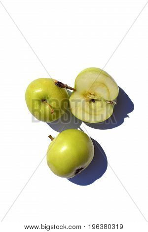 Green bright apples on a white background