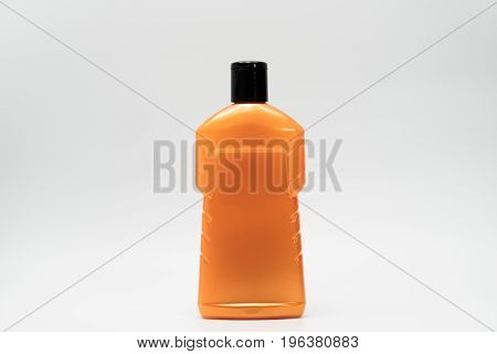 Orange cosmetic bottle isolated on white background