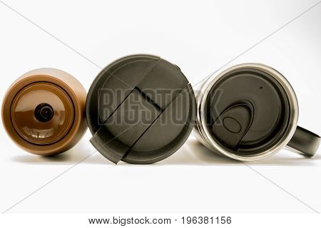 Lid of modern tumbler thermos on white background