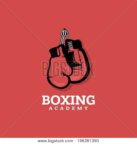 Boxing logo concept on red background with hanging boxing gloves. Vintage style.