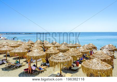 Beach with sunbeds an umbrelas in Skiros island Sporades Greece