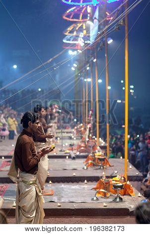 VARANASI, INDIA - JANUARY 3, 2016: Indian Brahmins conducts religious Ganga Maha Aarti ceremony (fire puja) at Dashashwamedh Ghat in Varanasi Uttar Pradesh India
