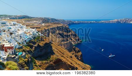 View of Fira village built on top of volcano cliff and blue sea Santorini island