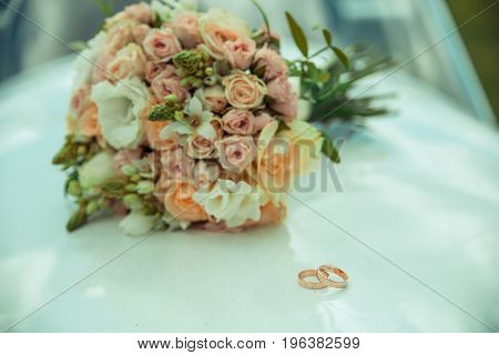Wedding rings and roses bouquet romantic, beauty, celebration, ceremony,