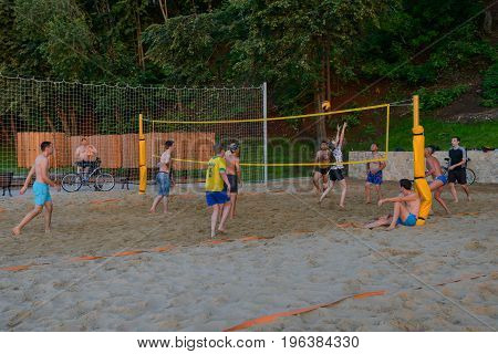 July 20 2017: A photograph of a company of young people playing volleyball on the beach. Cheboksary beach. Chuvashia. Russia.