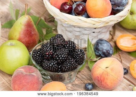 Healthy food, healthy eating - blackberry and other organic fruits on table