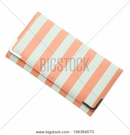 Stylish women's purse pink striped isolated on the white background. Close up of modern pink leather wallet over white background. Top view on the wallet.