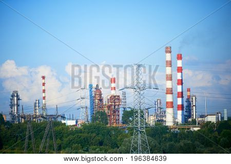 Factory pipes and smoke, industrial landscape photo