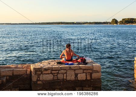 POREC CROATIA - JULY 14: Man relaxing next to the sea on July 14 2017