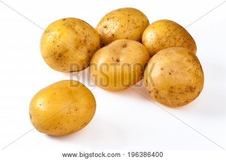 Pile of fresh yellow ripe potatoes isolated on white. Close up