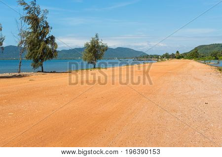 Dirt Road Along The Sea And Wild Empty Coast