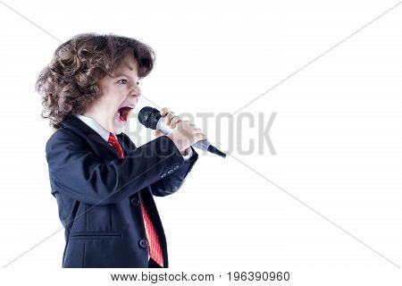 Little Curly Singer With A Microphone In Hands Sings A Song. In Profile. Close-up. White Background.