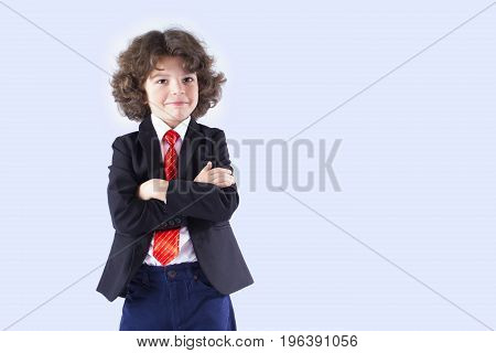 Curly Small Businessman With His Arms Crossed Smiling And Looking At The Camera. Gray Background.