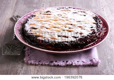 Mixed berry lattice toping pie on plate