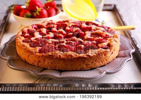 Strawberry cake served on plate on tray