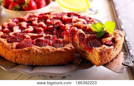 Strawberry cake sliced and served on plate