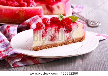Raspberry cheesecake with jelly topping served on plate