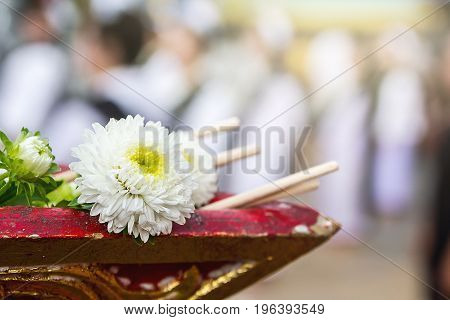 Flower on the tray with pedestal in ordination ceremony Buddhism tradition