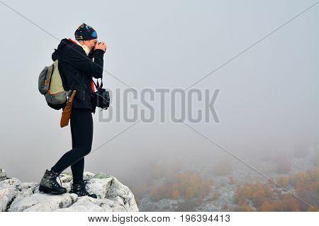 Cernei Mountains Romania - October 23 2015: Womn photographer during a hike in Cernei Mountains Romania. Shot taken on October 23rd 2015