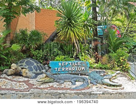 BANGKOK THAILAND - JULY 6 2017 : Garden ornaments in the front of exhibition about Reptile Terrarium at Dusit zoo.