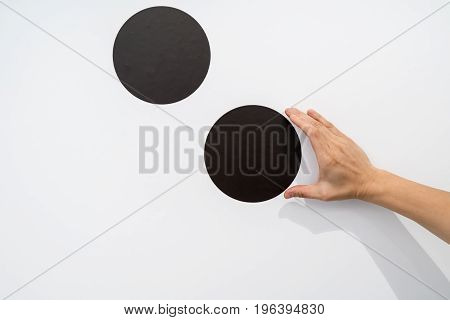 Woman Using Hands With Dot Graphic On White Wall
