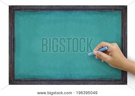 The hand that catches Chalk is preparing to write the alphabet on empty green chalkboard with black wooden frame isolated on white background vintage wall texture background.