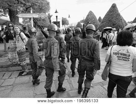Bangkok Thailand May 14 2013: The Order of Honor Guard goes past tourists.