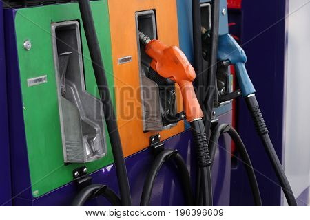Pump nozzles at the gas station, transportation power concept.