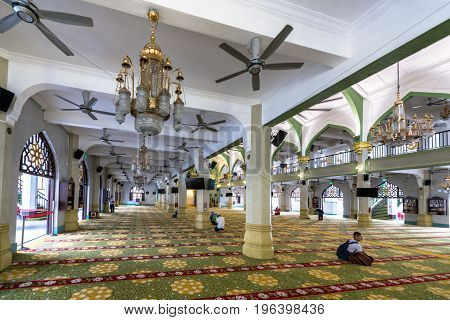 SINGAPORE - MARCH 22 2017: Muslim people praying at Masjid Sultan in Kampong Glam district in Singapore
