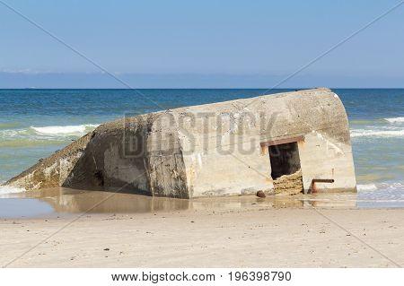 German World War II concrete bunker half submerged, Skiveren beach in Vendsyssel, Denmark