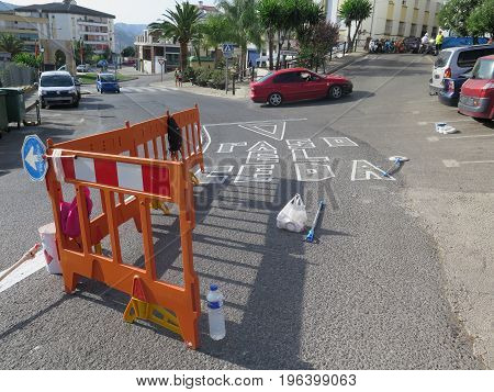 Alora Spain - July 19. 2017: Lunch break for workers painting warnings on road in andalusian village