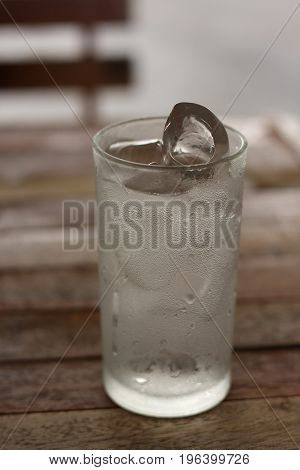 a glass of drinking water with ice.