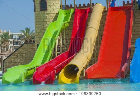 Water Slides At A Large Swimming Pool In Luxury Tropical Hotel