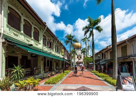 SINGAPORE - MARCH 22 2017: Wide angle picture of the way with many restaurants to Masjid Sultan Mosque in Kampong Glam district of Rochor Planning Area in Singapore
