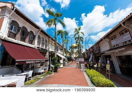SINGAPORE - MARCH 22 2017: Horizontal picture of the way with many restaurants to Masjid Sultan Mosque in Kampong Glam district of Rochor Planning Area in Singapore