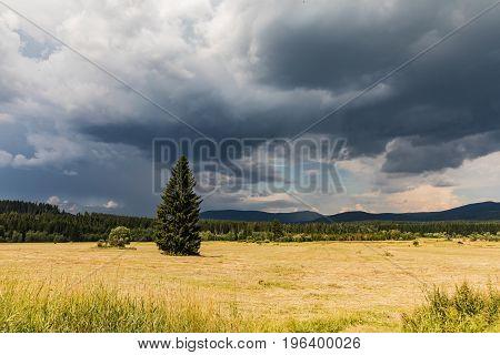 Summer landscape before storm Sumava Czech Republic. Dark clouds in Sumava south Bohemia landscape
