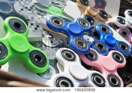 Fidget Spinners. Waterloo, Belgium - June 11, 2017. Assorted colorful fidget spinners close up. The popular hand spinner toys have become a worldwide trend.