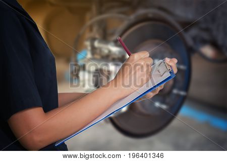 Asian Women Engineers And Technicians Are Checking Mechanic And Inspecting On A Car Wheel Brake Disc