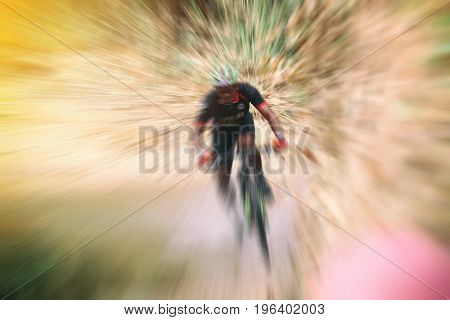 Blurry Of Sport. Mountain Bike Cyclist Riding Single Track And Cyclist Riding A Bike On An Off Road