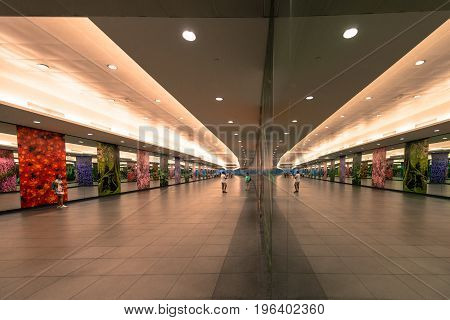 SINGAPORE - MARCH 22 2017: Way inside metro station with many mirrors paintings and lights in Singapore