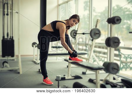 Women Asian Tying Shoe Laces. Fitness Women Getting Ready For Engage In The Gym