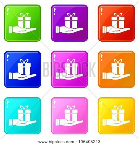 Gift box in hand icons of 9 color set isolated vector illustration