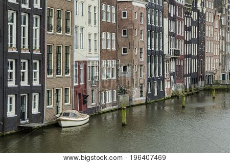 Old buildings on a canal in the center of amsterdam Holland
